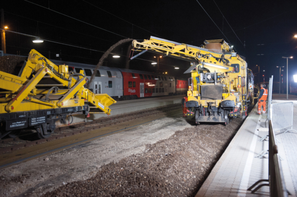 On/off-track ZRM 350 ballast cleaning machine during cleaning in a station area (Austria)