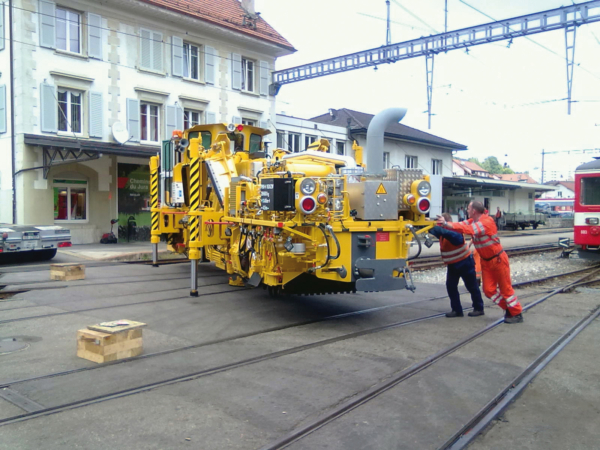 PBR-V 500 ZW ballast regulating and consolidating machine on hydraulic cylinders for re-railing
