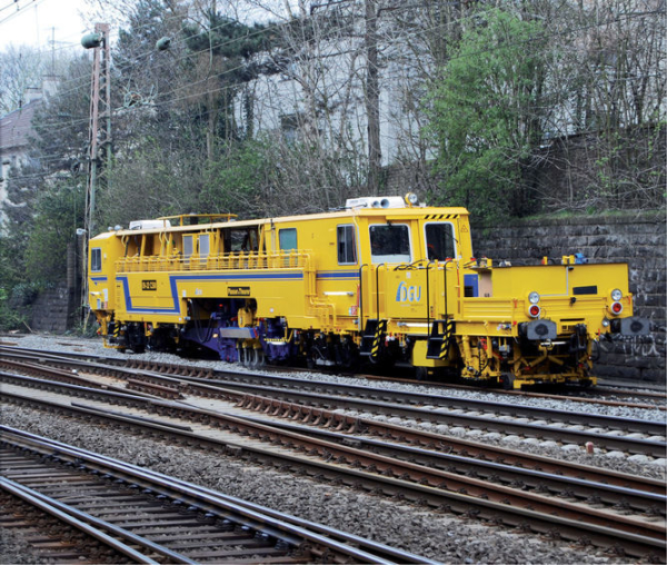 Duomatic 09-32 CSM during tamping after track renewal in Germany